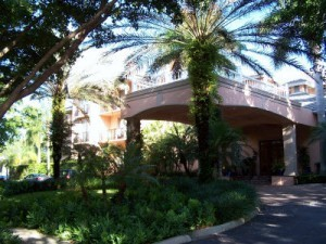 Trianon Hotel in Olde Naples front view with trees